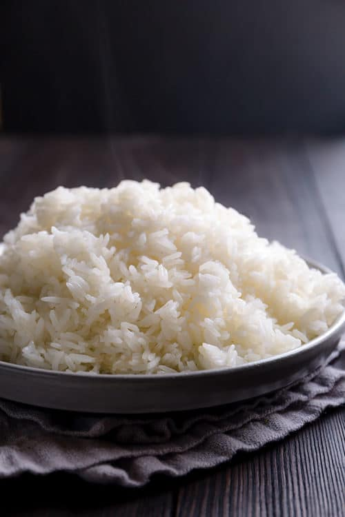 You don't need a rice cooker to make a perfectly fluffy white rice! Sharing my foolproof method to cook simple, yet deliciously fluffy white rice on stovetop and answering all your questions on how to cook rice on stovetop. #rice #whiterice #jasminerice #howtocookrice