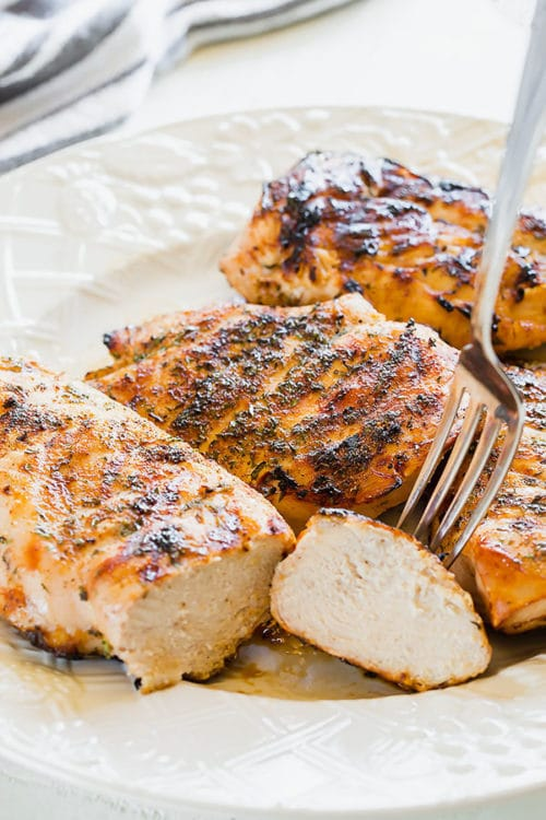 This simple lemon juice and dry rub combination is perfect treatment for chicken breasts for grilling when you're short on time. #grilledchicken #grilledchickenbreast #chickenbreast #quickdinner #weeknightmeal #easydinner #chickendinner #busycooks