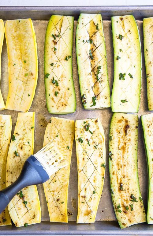 Shallow slits in zucchini and squash allow the marinade to soak deep into the flesh, adding more flavor. #grilledvegetables #vegetablemedley #mixedvegetables #sidedish #potluck #busycooks