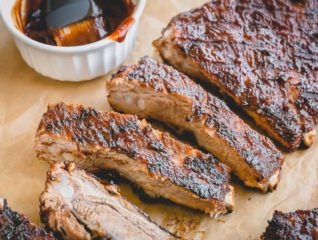 Quick and easy Instant Pot Ribs finished on the grill for a nice char and crispy caramelization. So much flavor in so little time! 1 hour is all you need! #instantpotribs #instantpotrecipes