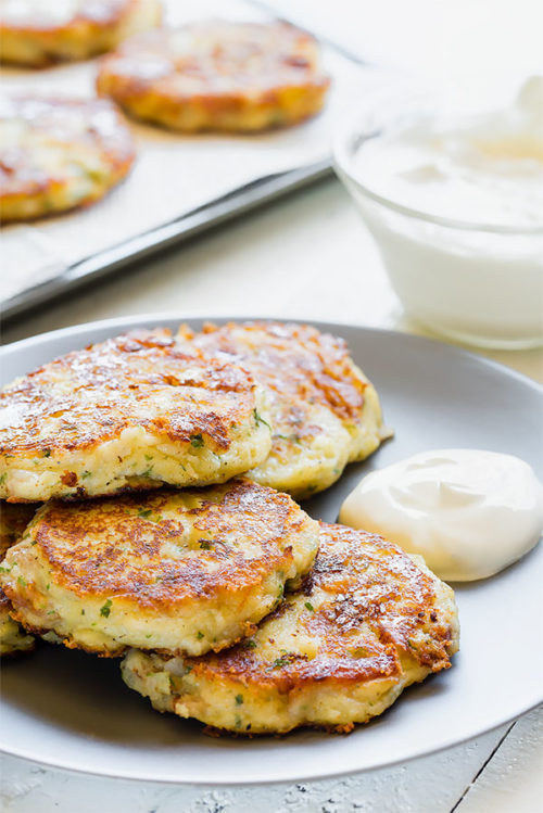 My kids LOVE these fluffy cheesy potato patties! Transform the leftover mashed potatoes into deliciously soft potato patties loaded with cheese, bacon and everything in between! #leftovermashedpotatoes #potatocakes #potatopatties #easydinner #sidedish #potatoes #busycooks