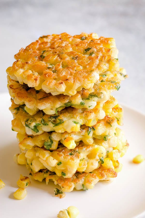 This easy corn fritters recipe makes delicately light and crisp fritters, studded with plenty of fresh sweet corns. All you need is simple ingredients and ONE bowl. #cornfritters