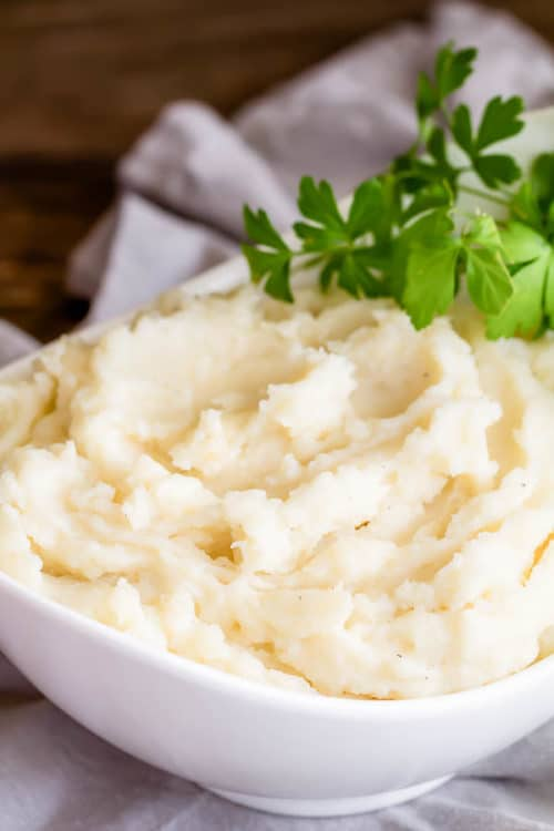 Ultimate mashed potatoes recipe collection. From classic to fancy, from stovetop to crockpot to pressure cooker, from fluffy to creamy, from vegan to loaded, there's every type of mashed potatoes one could request! #mashedpotatoes #sidedish #ThanksgivingSides