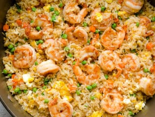 Faster than take-out, this spiced shrimp fried rice is so flavorful and easy to make! Everyone loves it, even the picky eaters! #friedrice #shrimp #shrimpfriedrice #quickdinner #easyrecipe #busycooks