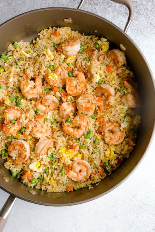 This quick and easy shrimp fried rice is comes together in less than 30 minutes. A family favorite quick dinner recipe for busy weeknights. #friedrice #shrimp #shrimpfriedrice #quickdinner #easyrecipe #busycooks