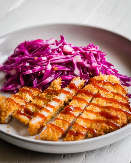Simple pork cutlets with satisfying light and crispy crust and juicy tender meat. It pairs beautifully with tangy quick red cabbage slaw. Perfect weeknight meal in under 30 minutes!