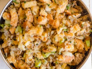 We transformed a classic stuffing recipe into an easy peasy Instant Pot Sausage Stuffing. Generous portions of flavorful fluffy sausage stuffing in less than 1 hour. #instantpotrecipes #instantpot #sausagestuffing #thanksgivingmenu #stuffing