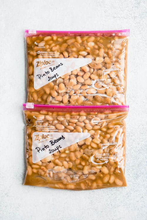 Learn how to cook dry pinto beans in a pressure cooker under 1 hour. Plus, storing tips for large batches of cooked beans. #pintobeans #drybeans #instantpotrecipe #busycooks
