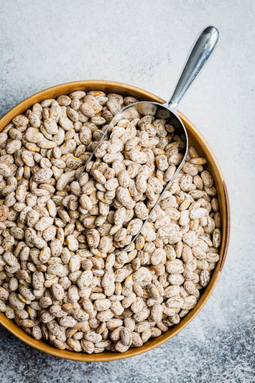 Everything you need to know about cooking with dried beans. Learn about the benefits of beans, different varieties, how to cook and store beans and more! #driedbeans #beans