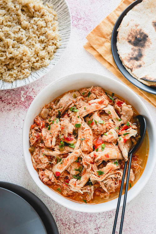This Instant Pot Salsa Chicken with brown rice might be the EASIEST dinner ever! Basically hands-free, this 3-ingredient one-pot meal comes together in less than an hour, and the Instant Pot does most of the work for you!
