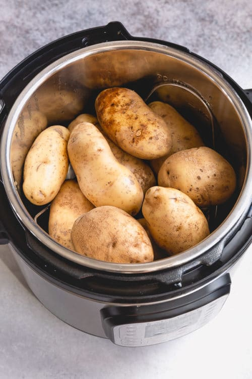 Instant Pot full of russet potatoes to make perfectly creamy and fluffy baked potatoes.