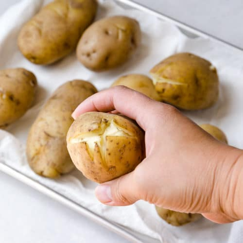 Baked potatoes with an X cut on one end of the potato. A smart trick for easy peeling...