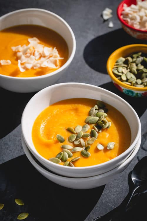 This coconut butternut squash soup is everything you wish for a cozy meal. It's velvety smooth and creamy, hearty with a hint of warm ginger and spices, naturally vegan and absolutely healthy! #butternutsquash #butternutsquashsoup