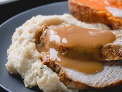 Instant Pot turkey breast, mashed potatoes, baked sweet potatoes, and gravy all in one pot! Yes, you can make an entire Thanksgiving dinner in an Instant Pot all at once! #thanksgiving #instantpotthanksgivingdinner #instantpotturkey