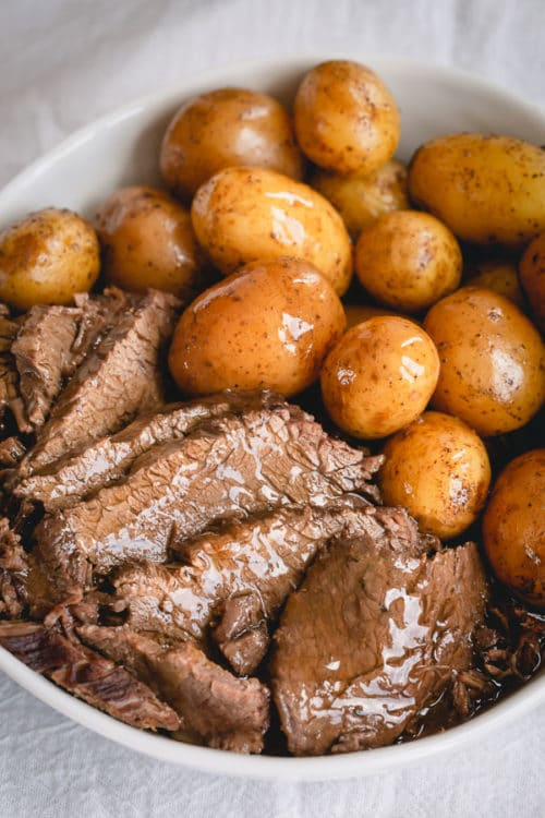 Melt-in-your-mouth tender pot roast with potatoes, barley AND rich gravy, all cooked in ONE pot in less than 90 minutes! #InstantPotrecipes #InstantPot #InstantPotPotRoast #potroast