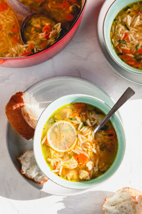 Our family's favorite lemon chicken orzo soup in less than 30 minutes. #chickenorzosoup #lemonchickenorzosoup