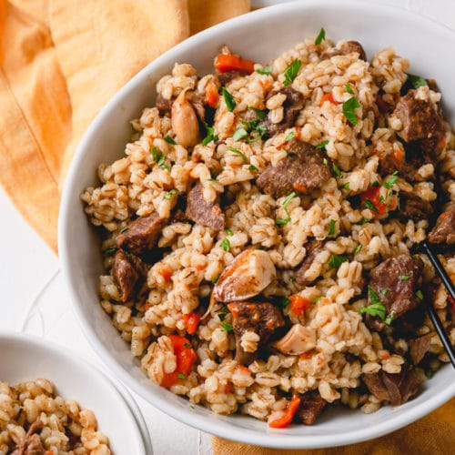 Beef and barley pilaf (beef plov) is a delicious and hearty dish cooked in Instant Pot in less than 1 hour! #InstantPotDinner #hulledbarley #barleypilaf