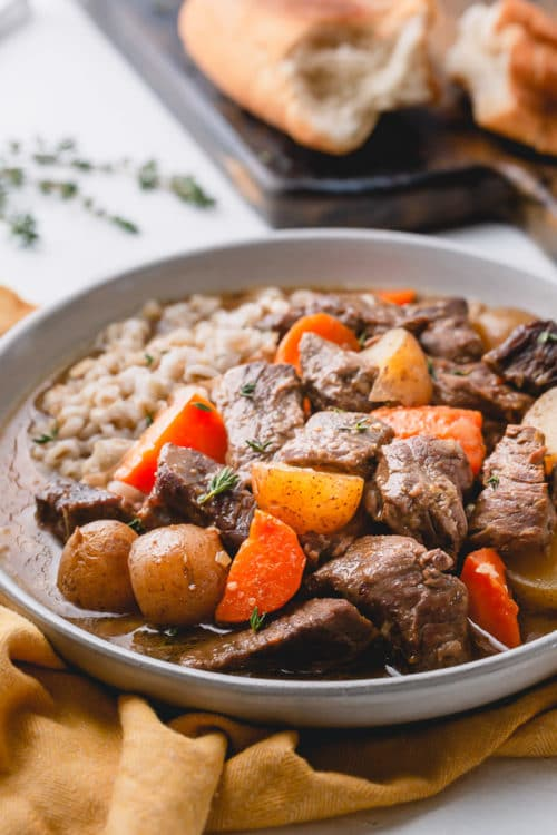 This Instant Pot beef stew is a rich and hearty comfort meal in less than 90 minutes and very minimal hand-0n time! The secret ingredients makes this stew extra-hearty! #instantpotbeefstew #beefstew