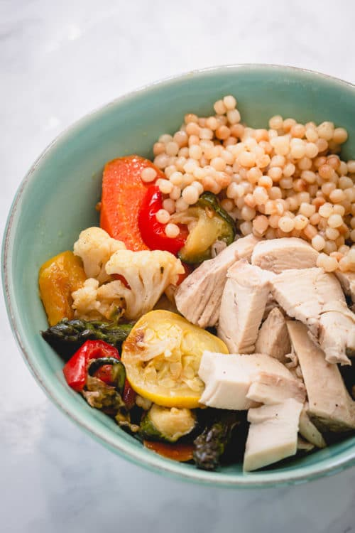 Mixing roasted veggies with grains and protein makes a satisfying quick meal.