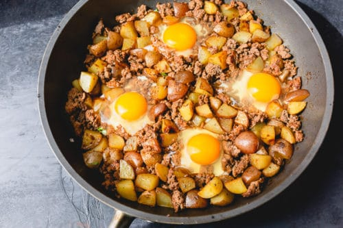 Optional step for delicious ground beef potato hash: make a few small wells and add eggs.